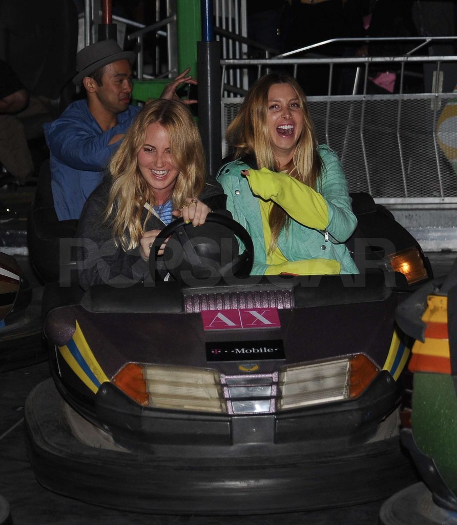 Whitney Port got silly on the bumper cars with a friend.