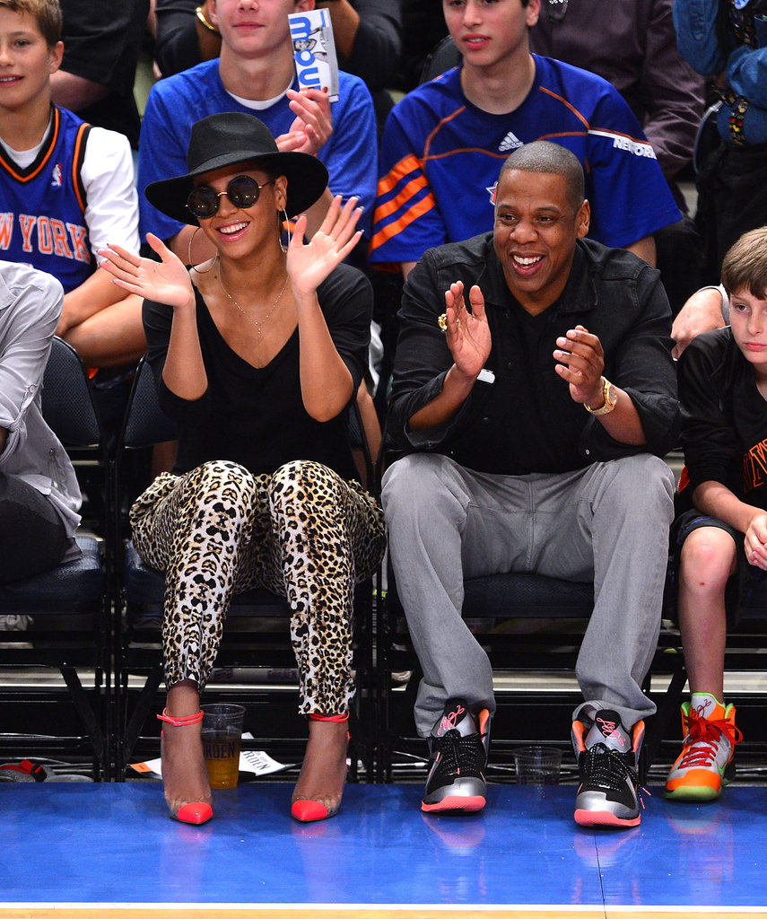 Jay-Z and Beyoncé Knowles watched basketball.