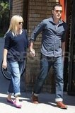 Pregnant Reese Witherspoon and her husband Jim Toth held hands.