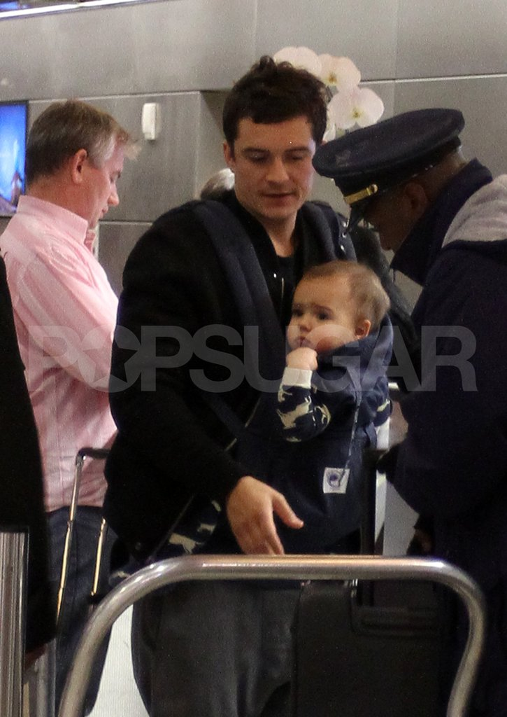 Orlando Bloom and son Flynn Bloom had help with baggage at LAX.