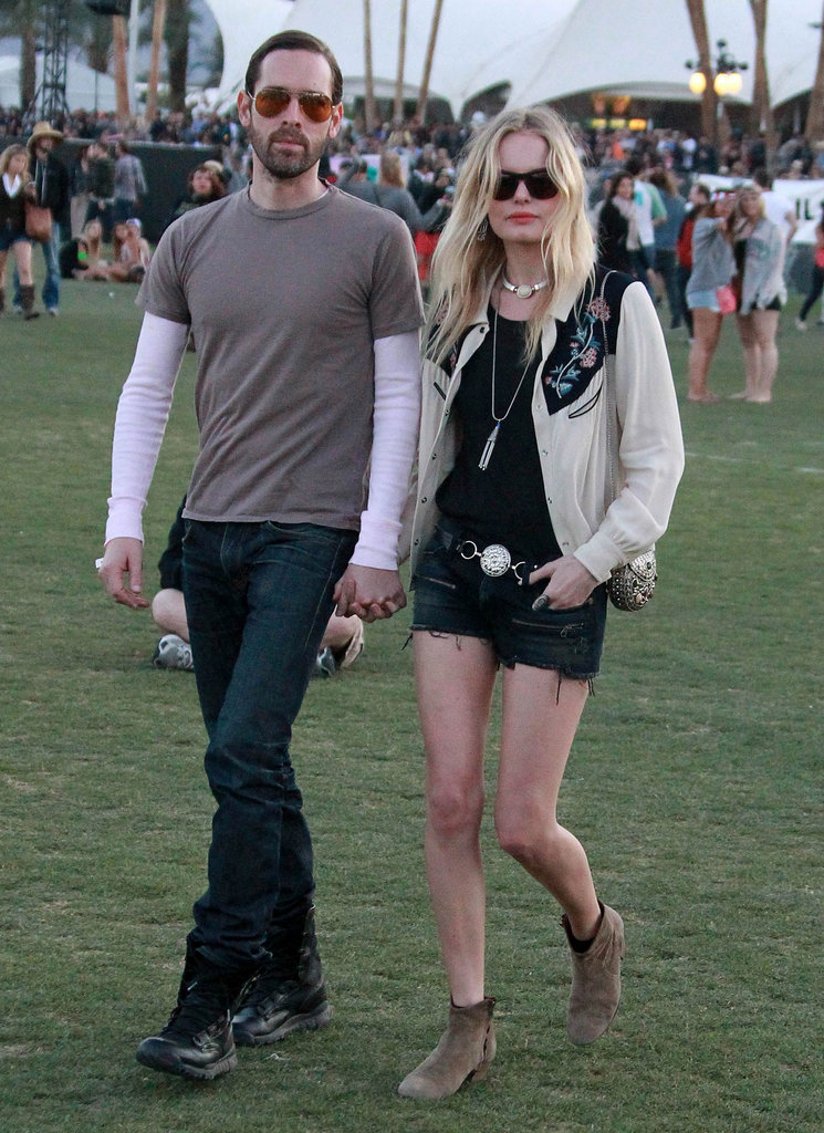 Kate Bosworth made her way around the festival with suede ankle boots, a Western-style top — both from Isabel Marant — cutoffs, and boyfriend Michael Polish at her side.