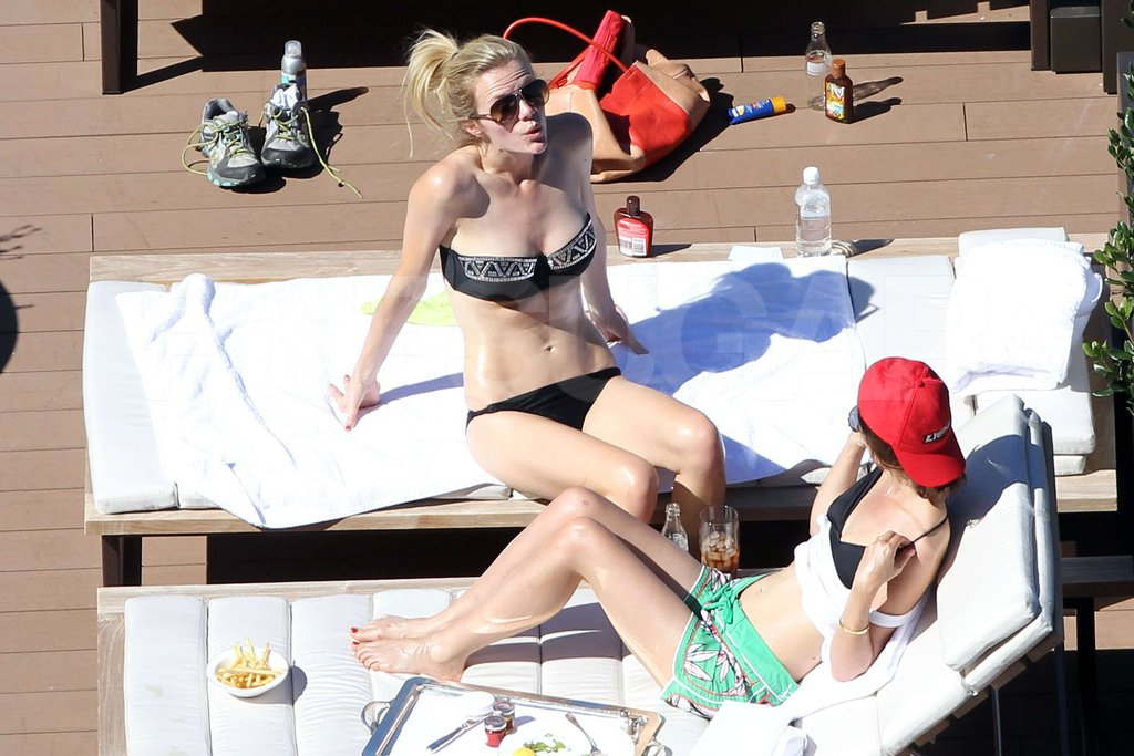 Brooklyn Decker laid by the pool sporting a black bikini in Australia.