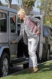 Gwen Stefani kept it casual in a loose up-do with her signature red lips in Orange County to celebrate Easter.