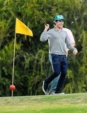 Zac Efron wore a turquoise hat on the course.