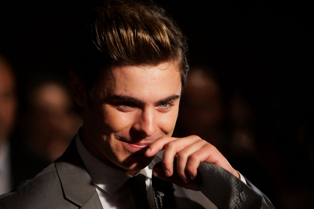 Zac Efron's blue eyes sparkled under the lights.