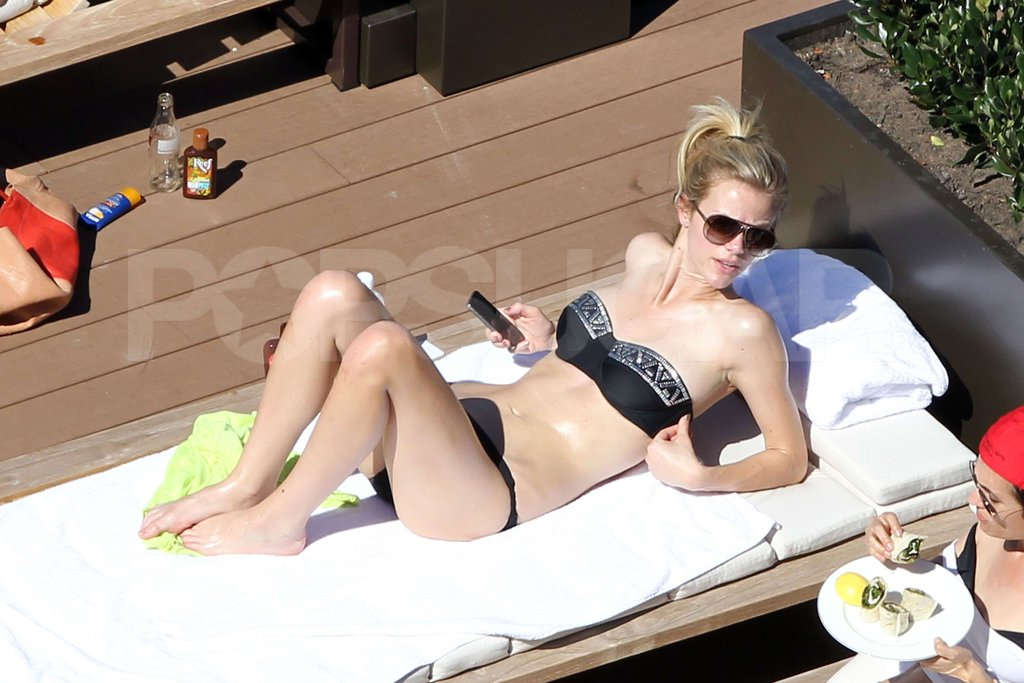 Brooklyn Decker wore a bandeau bikini poolside in Australia.