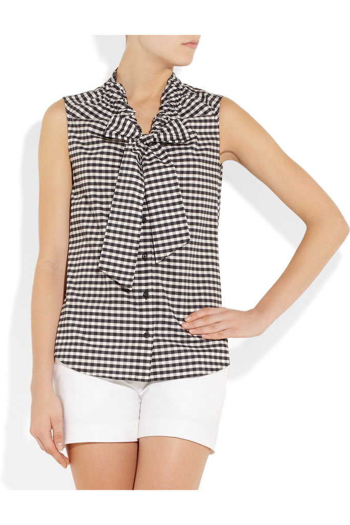 Gingham has to be one of our favorite prints right now — and paired with a sweet tie-front bow? We're sold.  Moschino Gingham Cotton Top ($695)