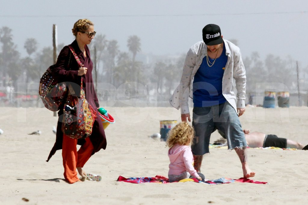 Nicole Richie and Joel Madden with Harlow and Sparrow at the beach in Malibu.