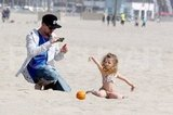 Joel Madden took pictures of Harlow posing in the sand.