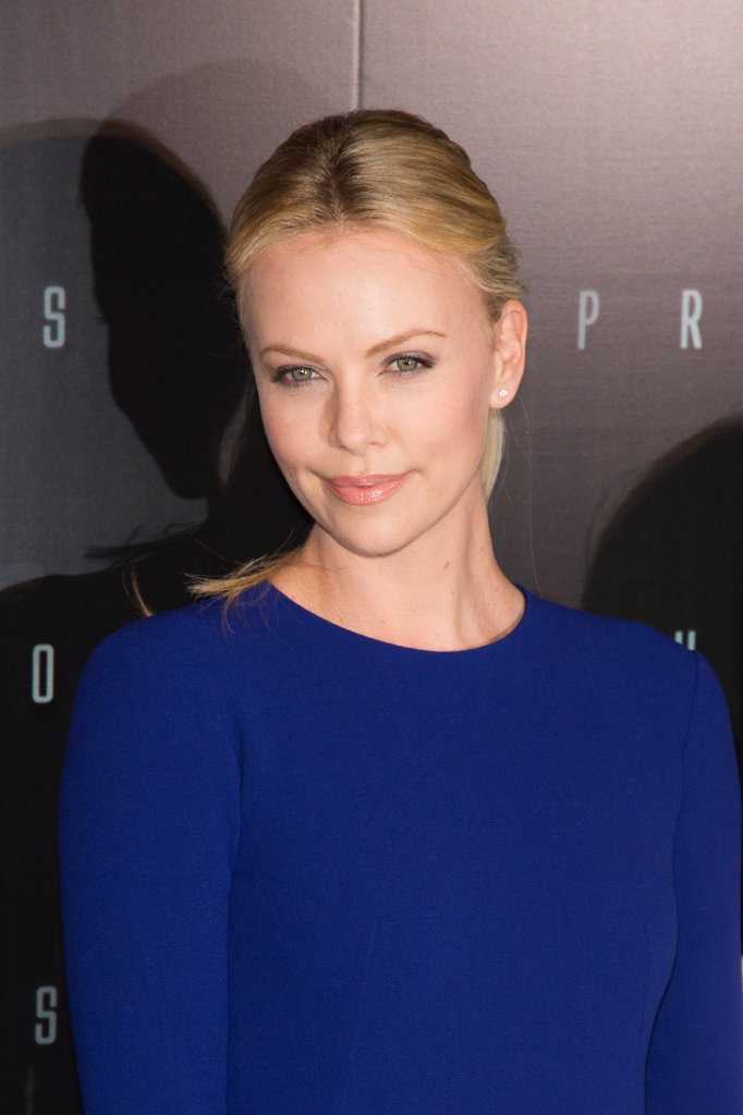 Charlize Theron wore a blue dress to the Prometheus premiere in Paris.