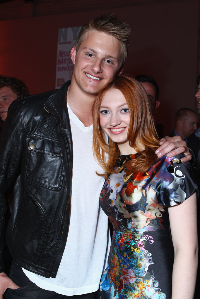 Alexander Ludwig put his arm around fellow Tribute Jacqueline Emerson.