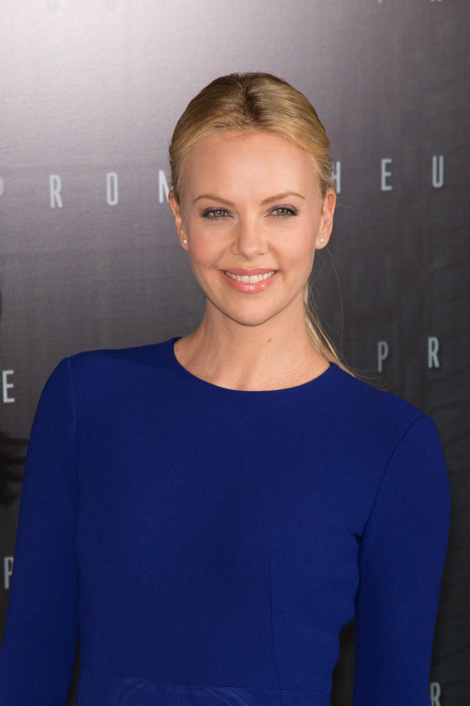 Charlize Theron gave a smile at the Paris Prometheus premiere.