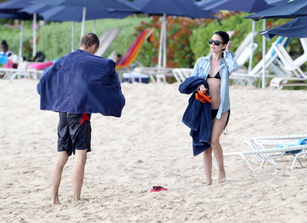 Hayden Christensen and Rachel Bilson dried off and got dressed as it began to rain on the beach.