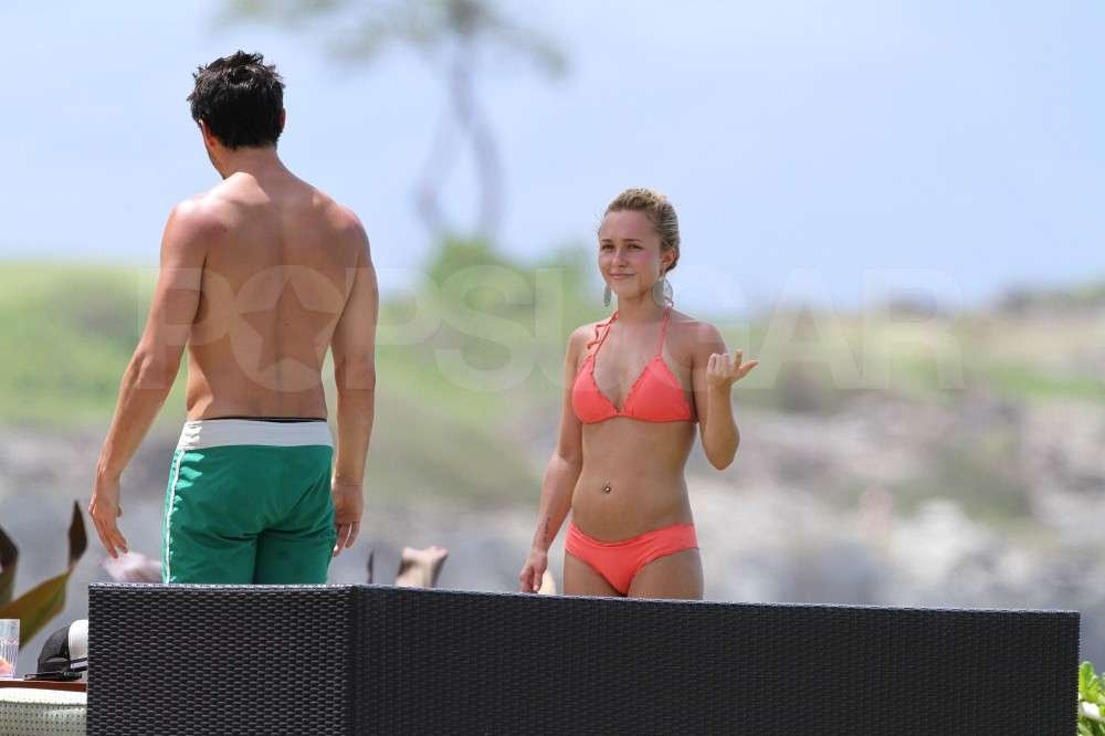 Hayden Panettiere spent time with boyfriend, New York Jets wide receiver, Scotty McKnight, lounging poolside in a bikini while vacationing in Hawaii.