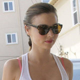Miranda Kerr keeps it classic in a pair of go-to shades.