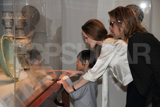 Angelina Jolie debuted her engagement ring while out in LA with husband-to-be Brad Pitt and Pax Jolie-Pitt at a private viewing of the Los Angeles County Museum of Art's Chinese Galleries.
