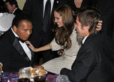 Angelina Jolie chatted with boxing legend Mohammad Ali and stroked Brad Pitt's hair at the December 2009 UNICEF Ball held in Beverly Hills.