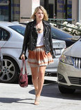 Ali Larter paired her Spring-ready skirt with a slouchy white tank and edgy leather jacket.