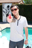 Josh Hutcherson posed poolside at the GUESS party.