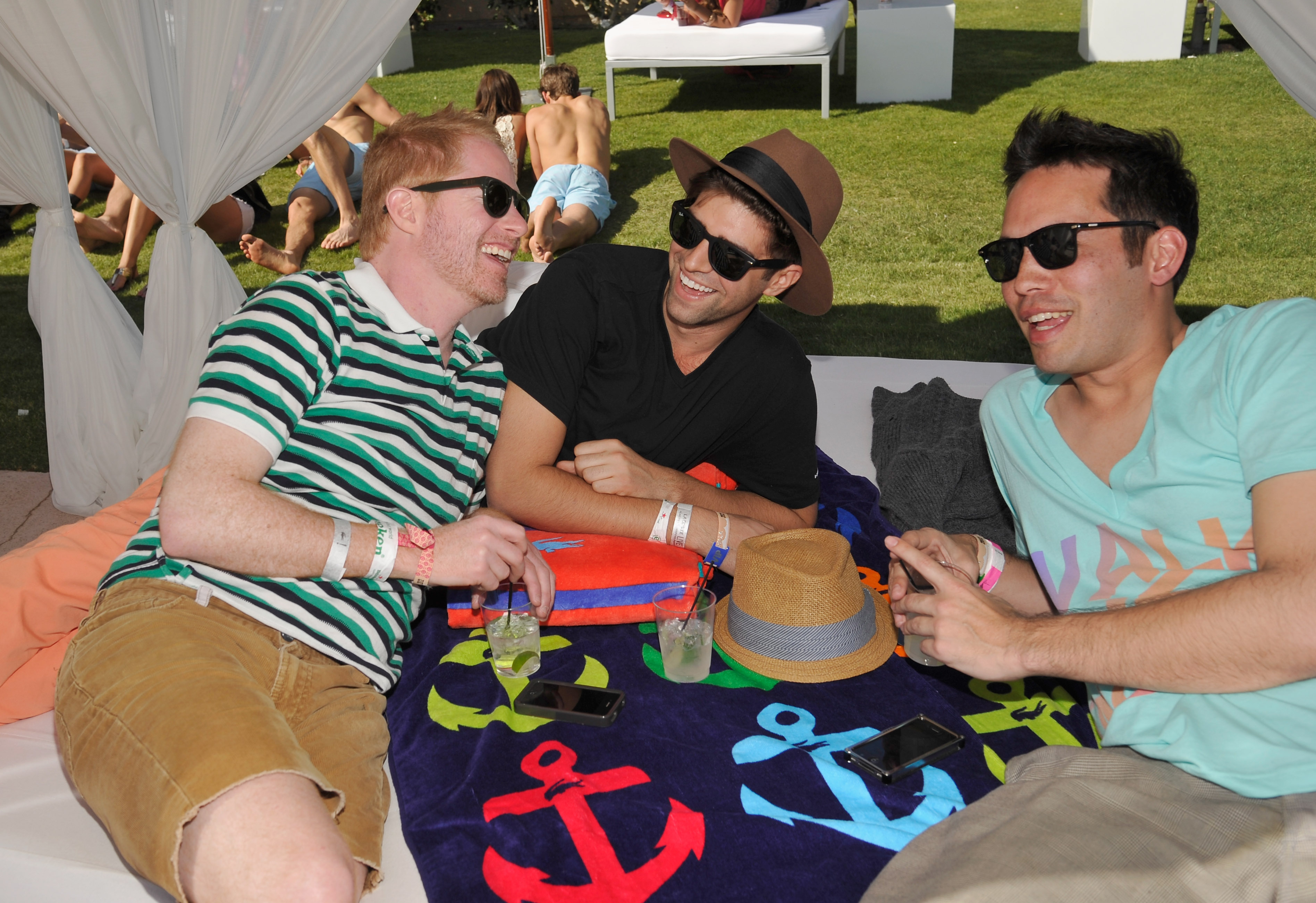 Jesse Tyler Ferguson and his boyfriend Justin Mikita lounged poolside at Lacoste's party on Saturday.