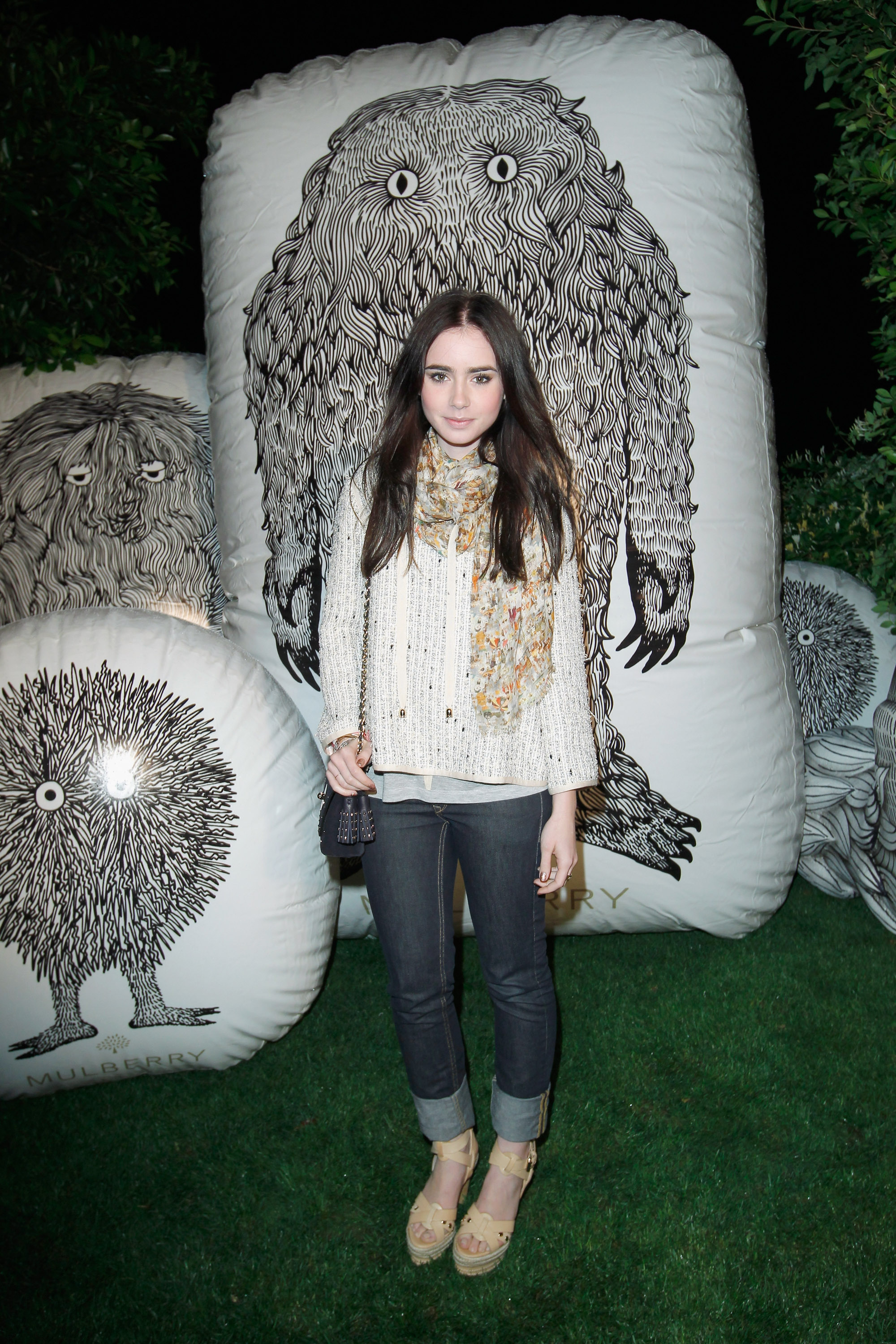 Lily Collins stepped out to support Mulberry on Friday at their Coachella party.