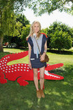 Diane Kruger posed with the gator at Lacoste! Live in a colorblocked Lacoste shirtdress, Isabel Marant booties and Jerome Dreyfuss Twee mini bag.