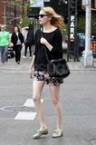 Emma Stone looked chic in floral shorts and oxfords as she strolled the streets of NYC.
