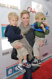 Julie Bowen showed off her supermom strength as she balanced two of her boys, John and Gus.