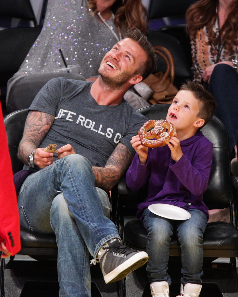 Cruz Beckham enjoyed a pretzel at the Lakers game with dad David Beckham.