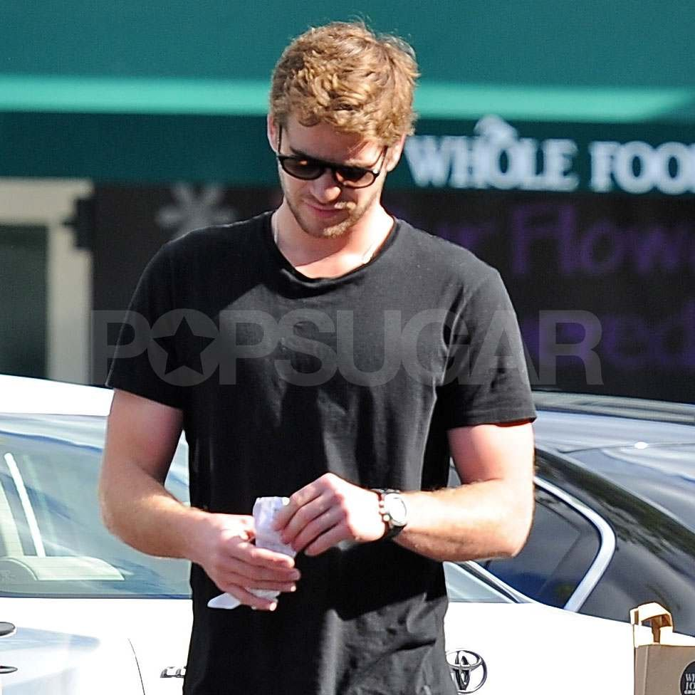 Liam Hemsworth wore a black shirt.