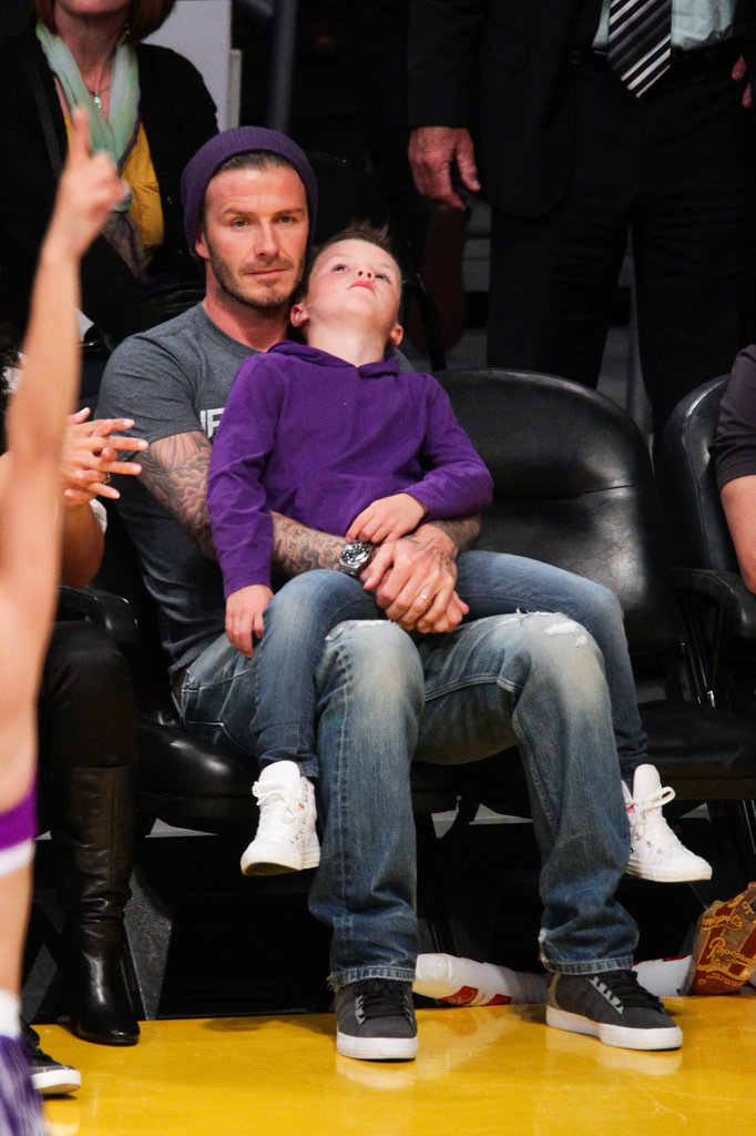Cruz Beckham sat on dad David Beckham's lap during the Lakers game in LA.