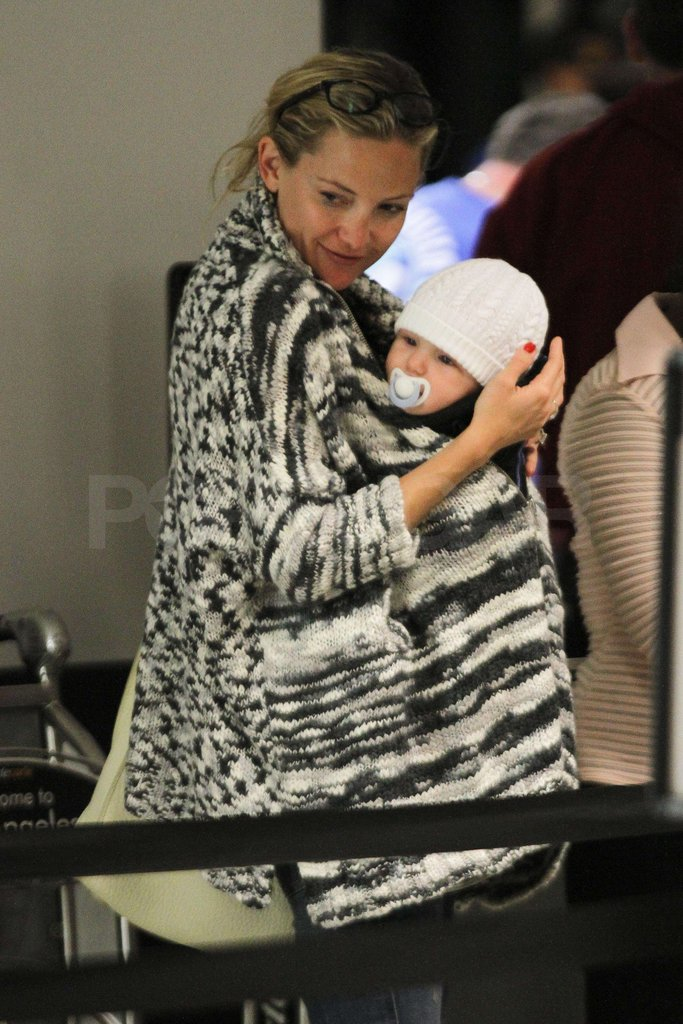 Kate Hudson cuddled Bing Bellamy close.