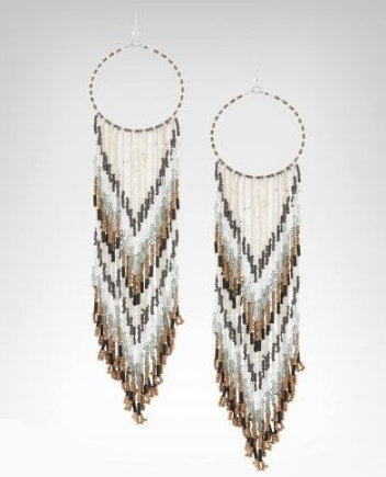 Reminiscent of a feather-decorated dream catcher, these wood and cylinder beaded hoop earrings are the perfect accessory for a playful Summer romper.  Bebe Long Seed Bead Hoop Earring ($39)