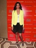 Rachel Roy added just the right yellow hue to her white top and black shorts for a casual-chic Spring style.