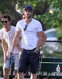 Liam Hemsworth wore a white t-shirt to golf.