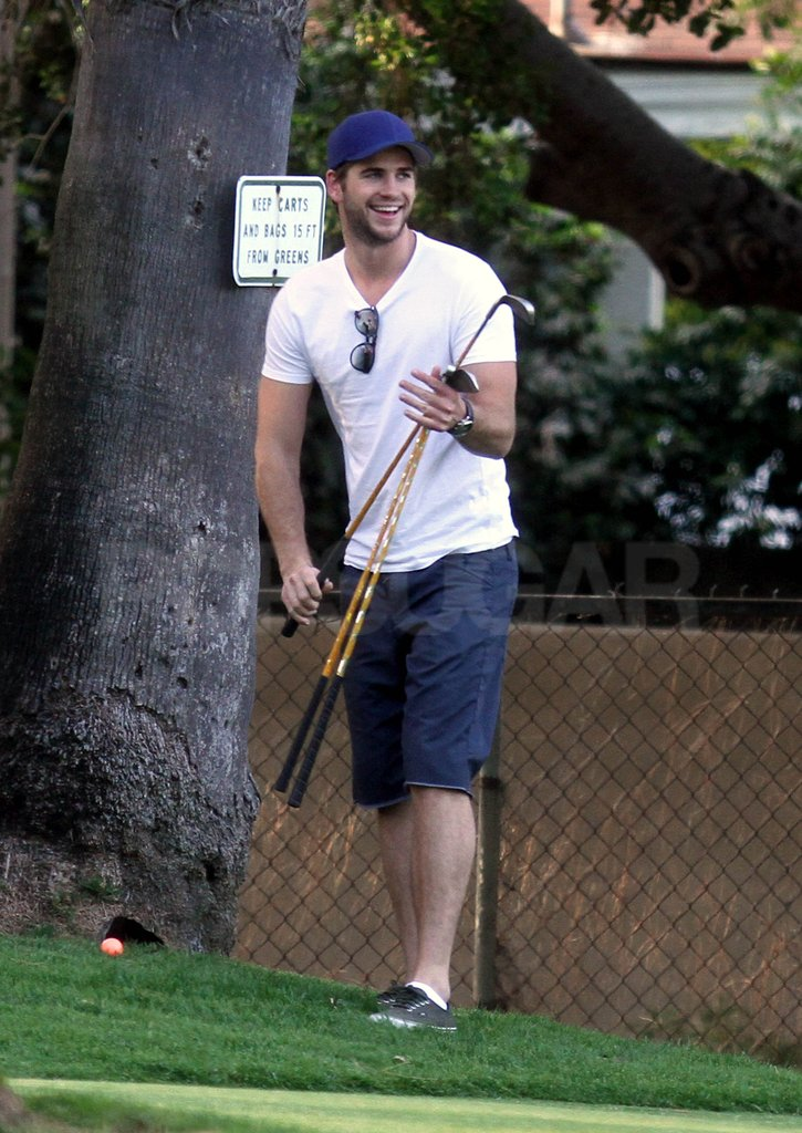 Liam Hemsworth was all smiles on the golf course.