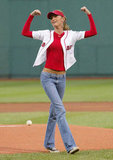 Gisele Bündchen showed her strength after she threw out the first pitch at the Boston Red Sox game in May 2004.