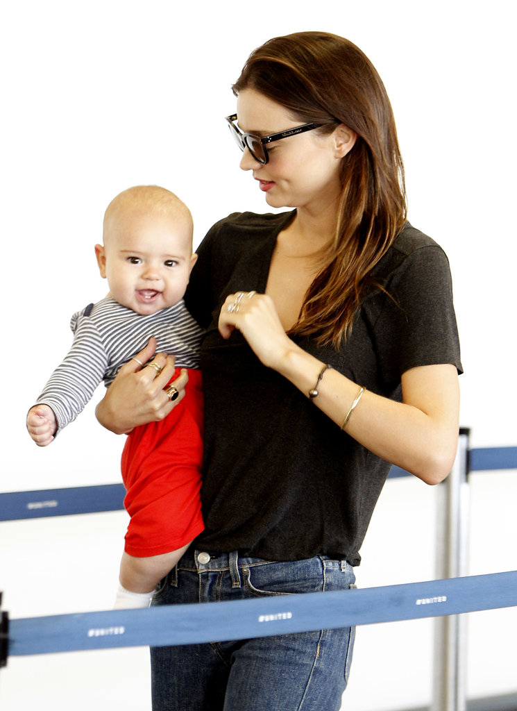 Tiny Flynn Bloom jetted out of LAX with Miranda Kerr in July 2011.
