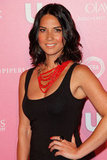 Olivia Munn added some brightness to her sexy LBD with a red beaded statement piece.