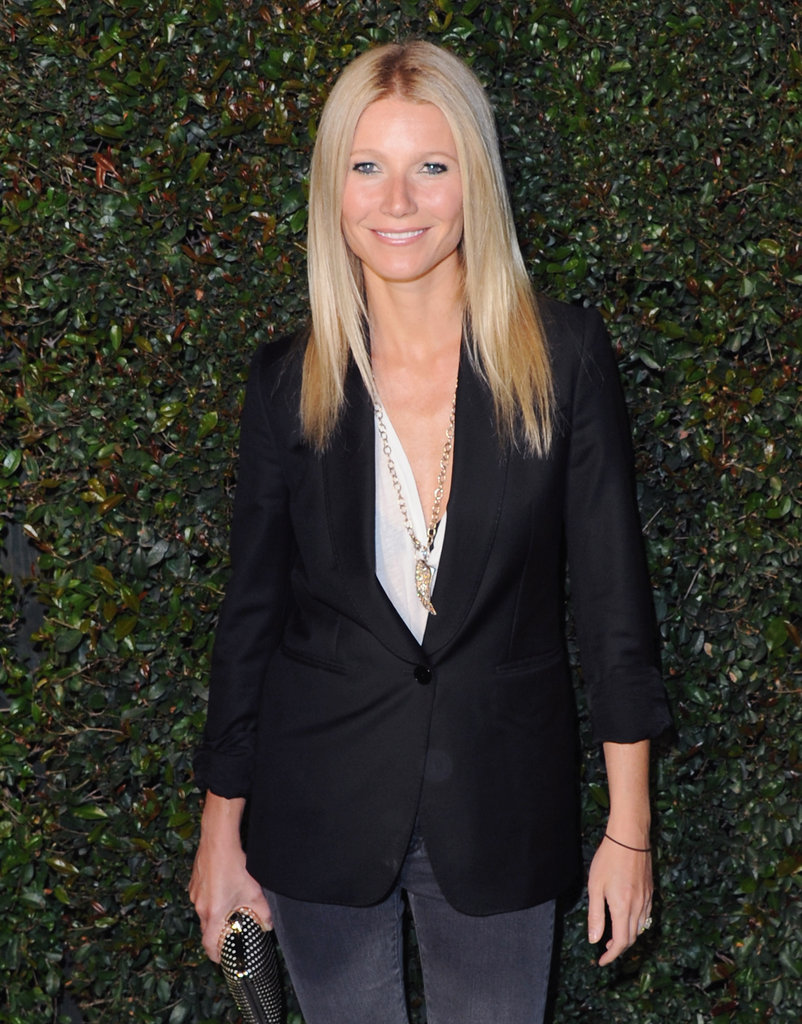Gwyneth Paltrow paired her tee and blazer with a simple yet stunning gold horn pendant.