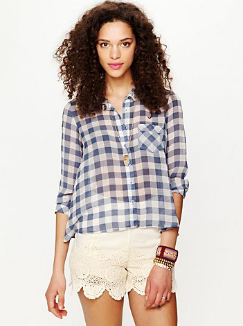 The sheer finish on this gingham find gives it a cool-girl factor you can play up with lace shorts or cutoffs.  Free People Sweet Spring Gingham Buttondown ($88)