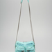 This ultra soft, slouchy turquoise lambskin is paired with coiled chain straps and exposed oversize zippers.