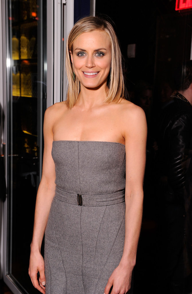 Taylor Schilling looked professional in a gray belted dress at the Cinema Society and Men's Health screening of The Lucky One in NYC.