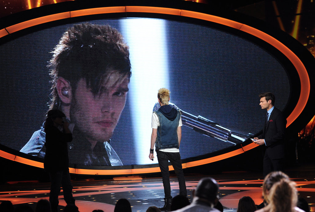Colton Dixon watched clips of his final performance.