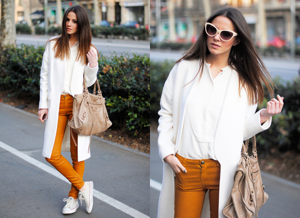 Pair monochromatic pieces with one bright accent — a bold orange pant will provide a serious style statement. Photo courtesy of Lookbook.nu