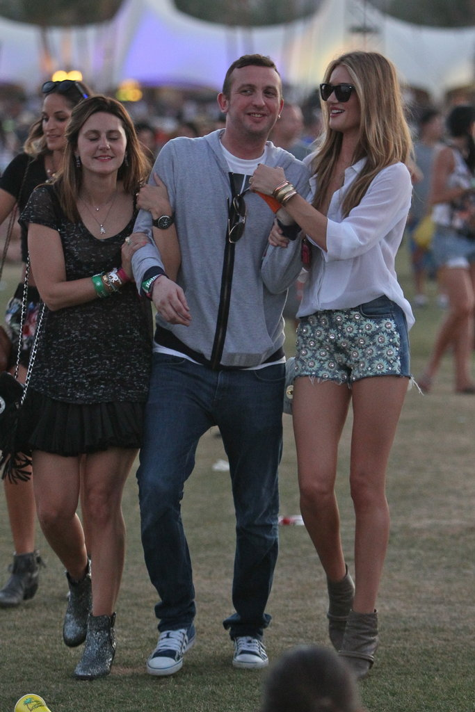 Rosie Huntington-Whiteley hung onto friends while enjoying the shows at the second weekend of Coachella.