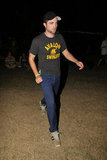 Robert Pattinson wore a black tee shirt and hat to Coachella's second weekend.