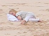 Vivienne Jolie-Pitt took a nap in the sand on their family vacation.