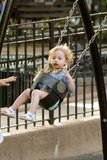 Sarah Jessica Parker gave her daughters a push on the swings at the park in NYC.