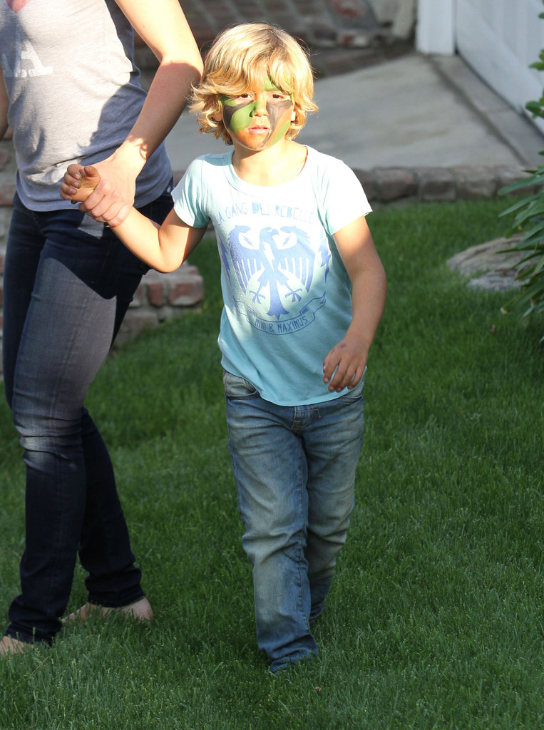 Kingston Rossdale sported camouflage his face paint after leaving a birthday party in LA with mom Gwen Stefani.